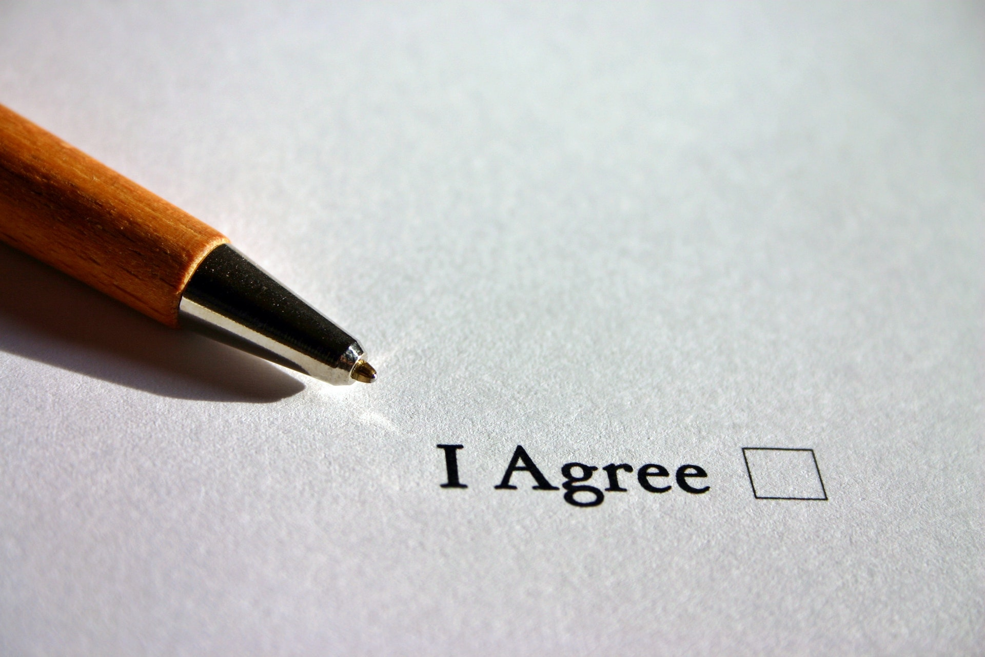 terms and conditions document signing agree tick box with pen